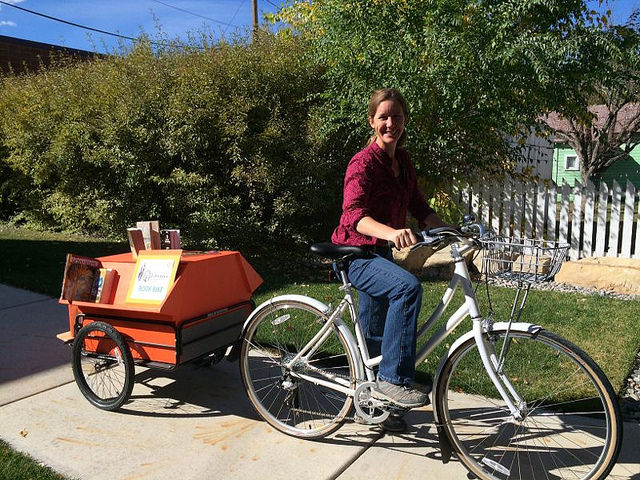 Anna Smedts on the Lander Library Book Bike. Anna works in interlibrary loan.