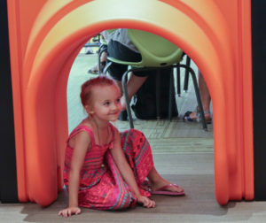 Little girl checking out the children's area.